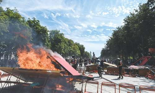 French police clash with protesters after man's death