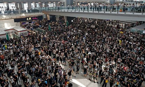 Over 5,000 protesters flood Hong Kong airport; flights cancelled