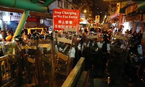 Trump links Hong Kong crisis to trade as China military rallies