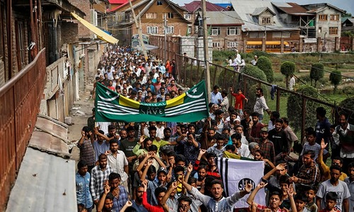 Besieged Kashmiri neighbourhood in test of wills with India's Modi