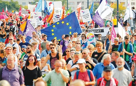 Thousands march against racism ahead of key state polls