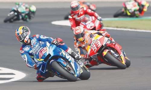 Rins pips Marquez at final corner to win British MotoGP