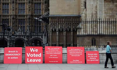 After election threat, British lawmakers begin no-deal Brexit showdown