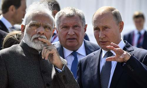 'Close friends' Putin and Modi vow to boost military, trade ties
