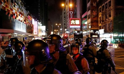 Hong Kong police fire tear gas as protests resume despite withdrawal of bill