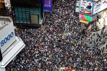 Protesters attend a pro-democracy march in the Causeway Bay district of Hong Kong on Sunday. — AFP