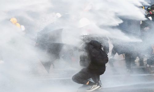 Tear gas, Molotovs mark 99th day of Hong Kong protests