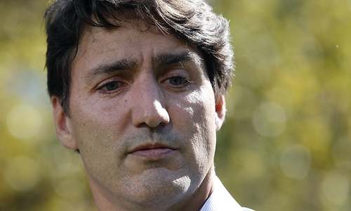 Canada's Trudeau apologises again for wearing blackface as new images emerge