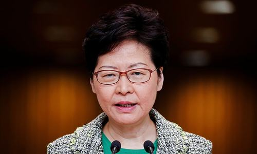 Hong Kong leader says police under extreme pressure; acknowledges 'long road' ahead