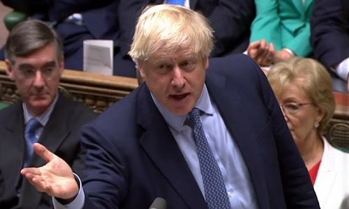 Johnson scrambles to sell Brexit deal to MPs