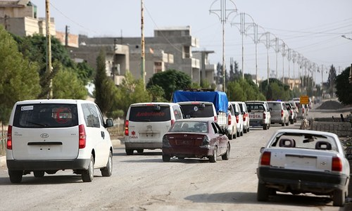 Kurds evacuate Syrian town in first pullout after ceasefire