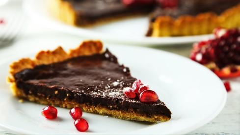 Welcome pomegranate season with this decadent chocolate tart recipe