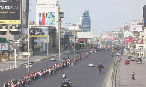 Lebanese protesters form 170-km nationwide human chain