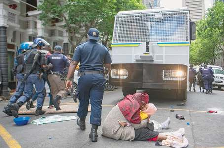 South Africa police evict protesting asylum-seekers, arrest 100