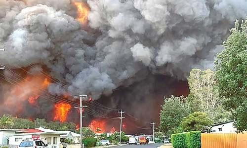 Firefighters betray helplessness as blazes ravage Australia's east