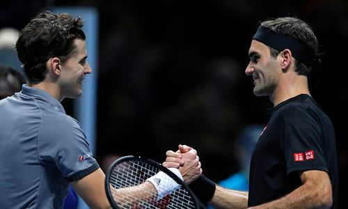 Thiem beats Federer at ATP Finals; Djokovic cruises