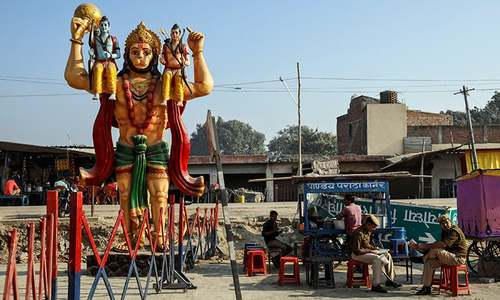 A statue of Hindu monkey god Hanuman is seen next to security barricade as police officers take a break after SC's verdict on a disputed religious site, in Ayodhya, India, November 11. — Reuters