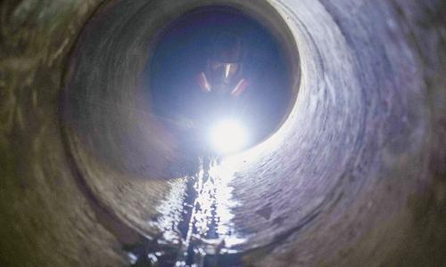 Desperate HK protesters explore sewers in bid to escape campus