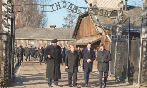 Merkel voices 'deep shame' on first  visit to Auschwitz