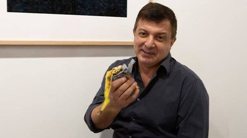 A banana duck-taped to a wall became art worth $120,000. This man just ate it