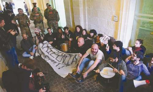Activists storm into Maltese govt HQ, call for PM's resignation