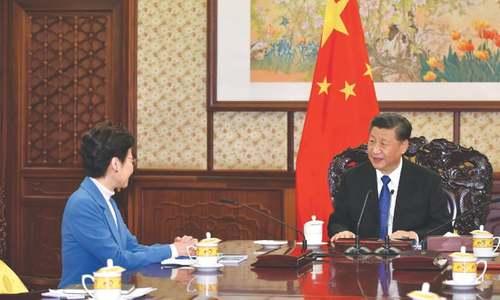 Xi gives Hong Kong leader 'unwavering support'