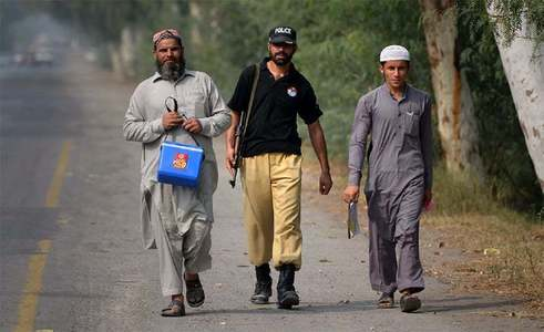 Two cops escorting polio team martyred in KP attack