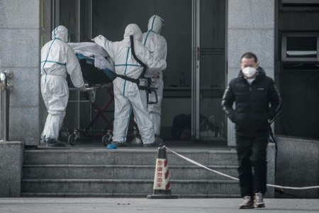 China confirms human-to-human transmission as SARS-like virus spreads