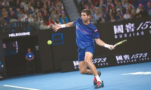 Nadal, Kyrgios through as freak weather hits Australian Open