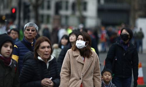 UK officials say 2 people test positive for novel coronavirus
