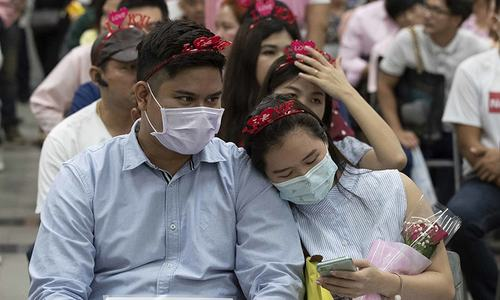 In pictures: Hearts, flowers and masks — Valentine's Day in the time of coronavirus
