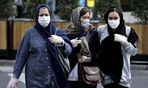 Amid disqualifications and coronavirus cases, conservatives claim victory in Iran polls