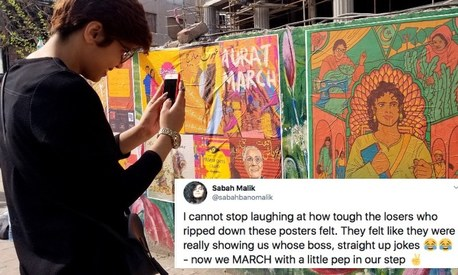 Women peacefully put up Aurat March posters, men violently tore them down