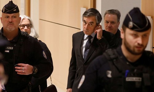 Former French PM and wife go on trial for fraud