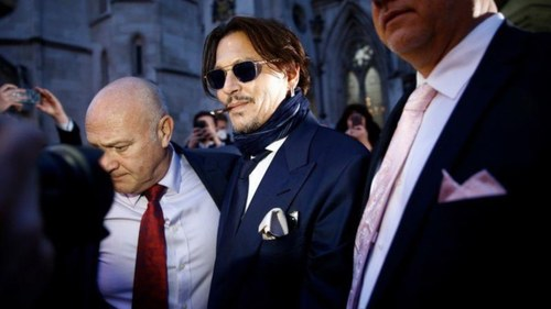 Johnny Depp sues British tabloid for calling him a 'wife beater'