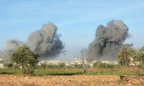 Battle rages for strategic town in north-western Syria