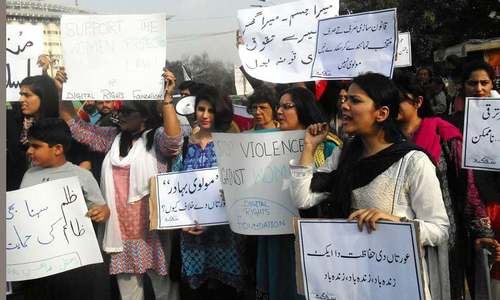 Women hold torch-bearing rally for rights in Peshawar