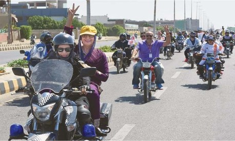 Women bike across Karachi for International Women's Day