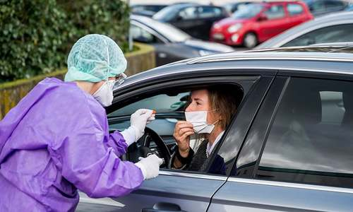 German hospital creates drive-through for swab testing as coronavirus cases rise in Europe