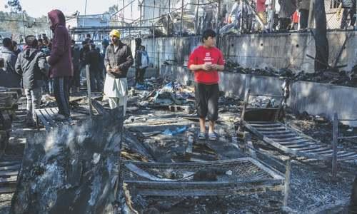 Child dies in Greek migrant camp fire