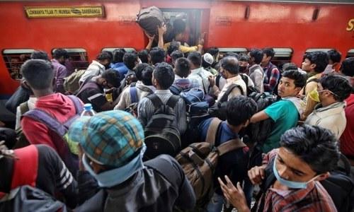 Poor Indians flee to villages as coronavirus measures take heavy toll