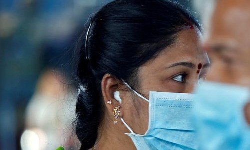 South Asian governments impose coronavirus curfews, border controls