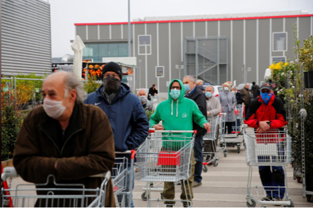 People queue to enter a hardware store during a partial reopening after the Austrian government eased restrictions following Covid-19 outbreak in Eisenstadt, Austria, April 14. — Reuters