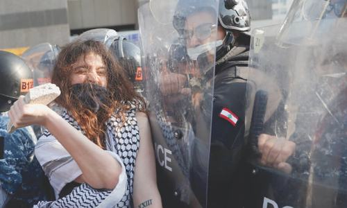 Lebanese riot on streets as economy crumbles