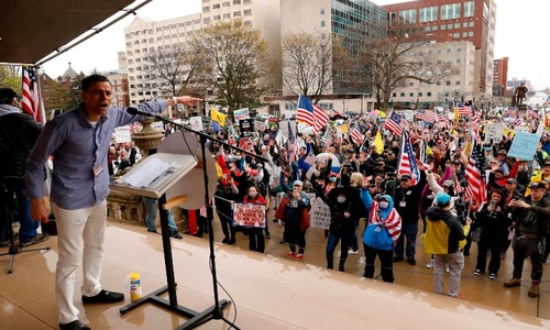 Hundreds protest extension of lockdown in Michigan