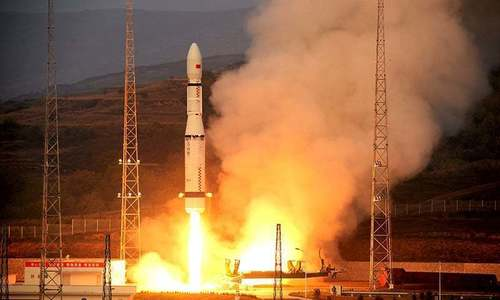 China launches rocket, spacecraft prototype