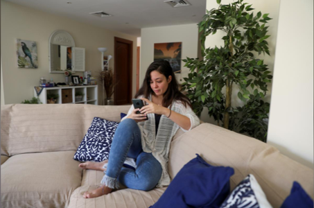 Egyptian-American architect Nada Karim checks her phone at her house in Dubai, UAE, May 7. — Reuters