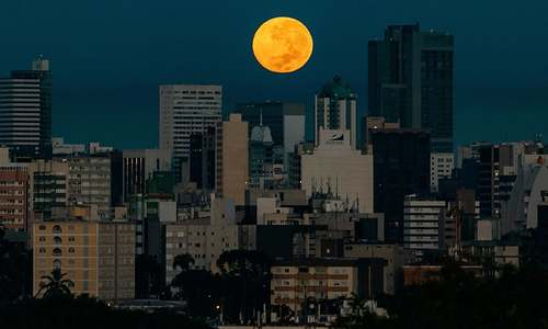 In pictures: Last supermoon of 2020 rises on a world grappling to overcome pandemic