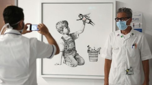 New Banksy art thanking superhero nurses appears at hospital