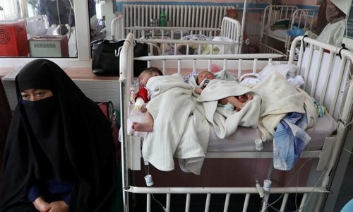 Babies that lost their mothers in the attack lie on a bed. — Reuters
